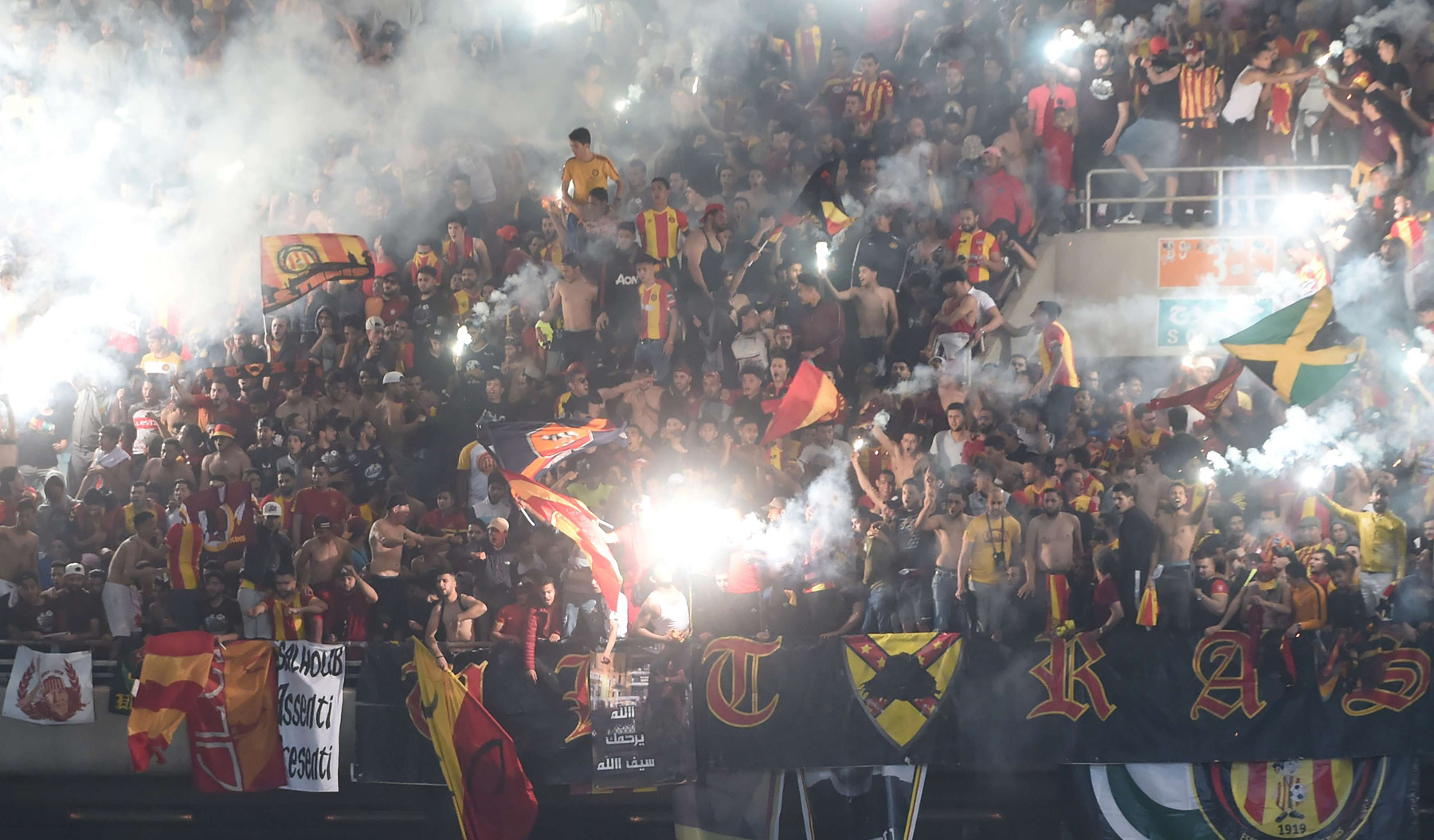 Esperance supporters react during the second leg of the 2019 CAF Champion League finals between Tunisia's Esperance and Morocco's Wydad Casablanca. (AFP)