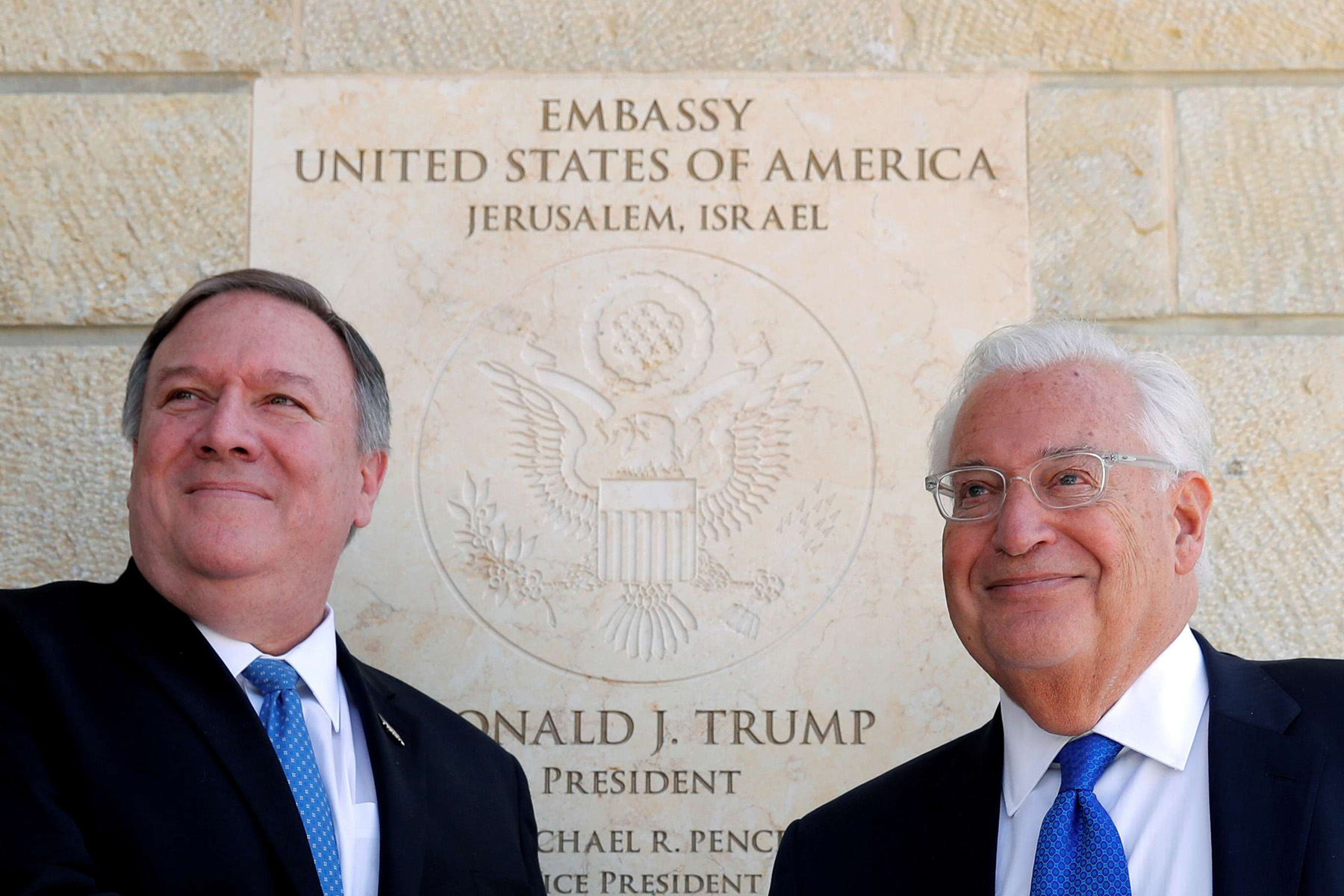 US Secretary of State Mike Pompeo and US Ambassador to Israel David Friedman stand next to the dedication plaque at the US embassy in Jerusalem, on March 21. (Reuters)