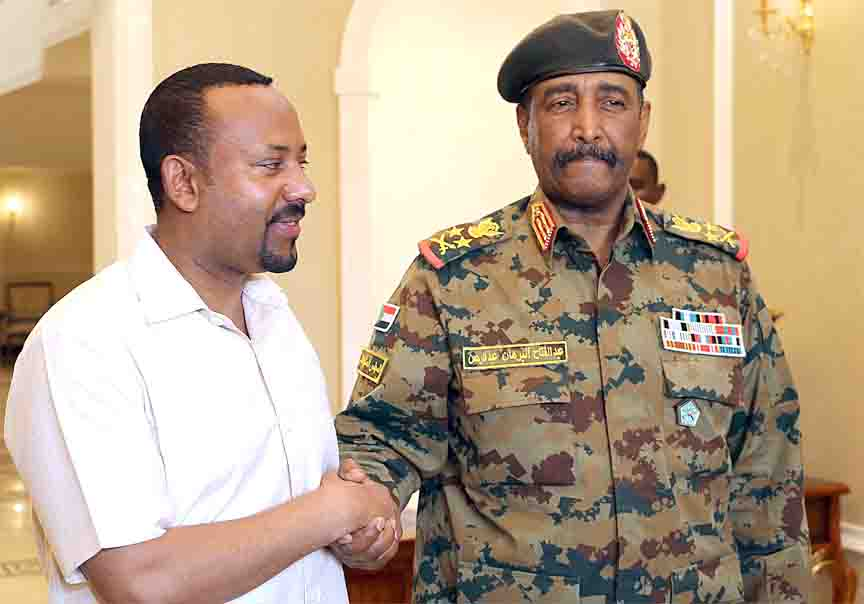 Successful foreign intervention. Ethiopia's Prime Minister Abiy Ahmed (L) meets with the chief of Sudan's ruling military council General Abdel Fattah al-Burhan in Khartoum, June 7. (AFP)