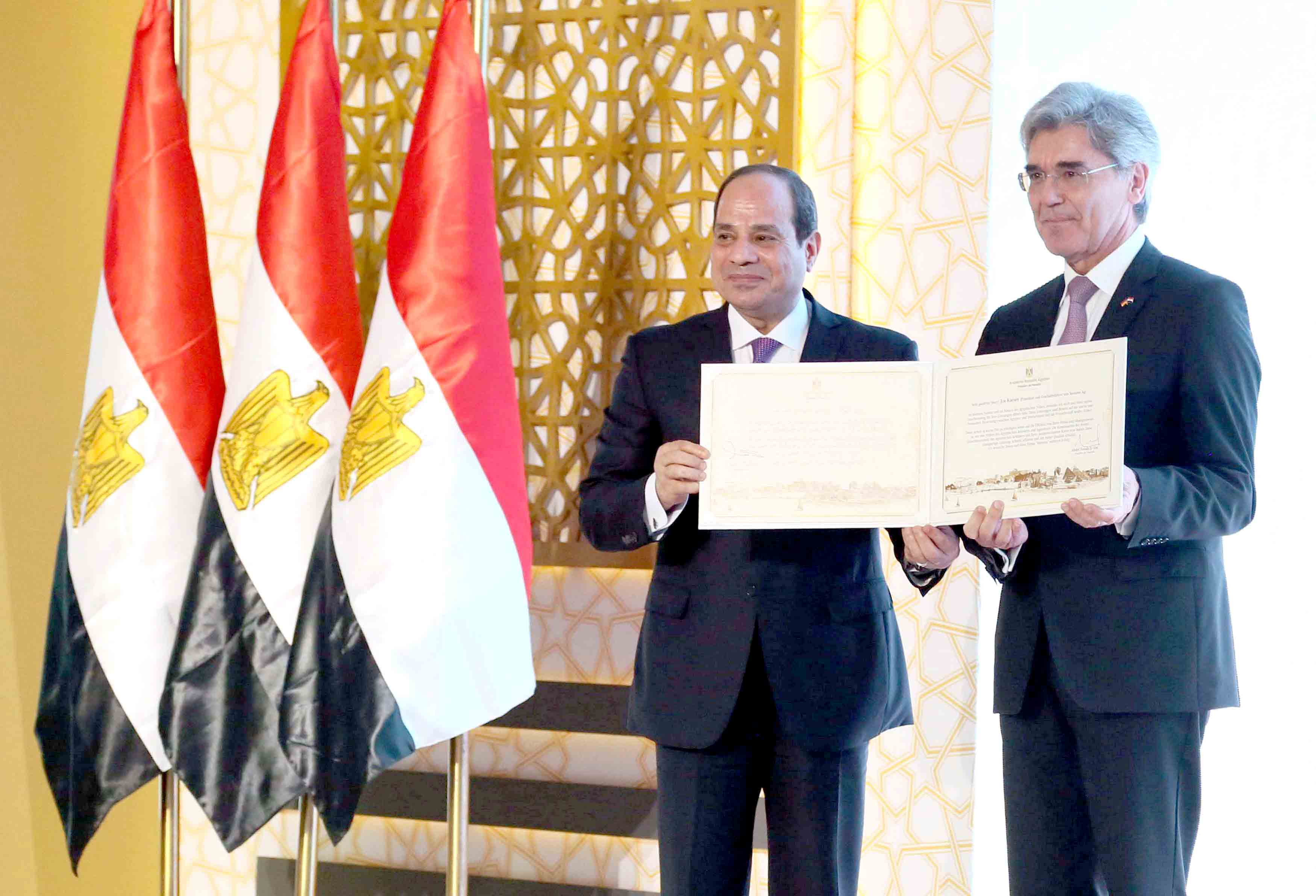 Egyptian President Abdel Fattah Al Sisi (L) and Joe Kaeser, chief executive of German engineering group Siemens attend the inauguration of major power stations in the energy sector, at Egypt's new administrative capital, north of Cairo, Egypt, July 24, 2018 in this handout picture courtesy of the Egyptian Presidency. The Egyptian Presidency/Handout via. (Reuters)