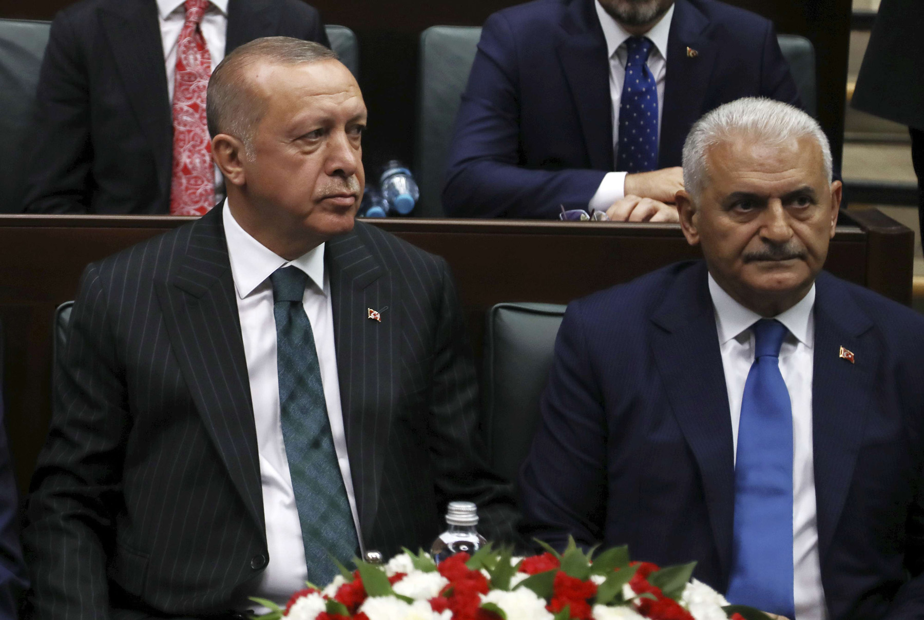 Loser and friend. Turkey's President Recep Tayyip Erdogan (L) with Binali Yildirim, his mayoral candidate for Istanbul, attends a parliament session in Ankara, Turkey, June 25, two days after  elections(AP)