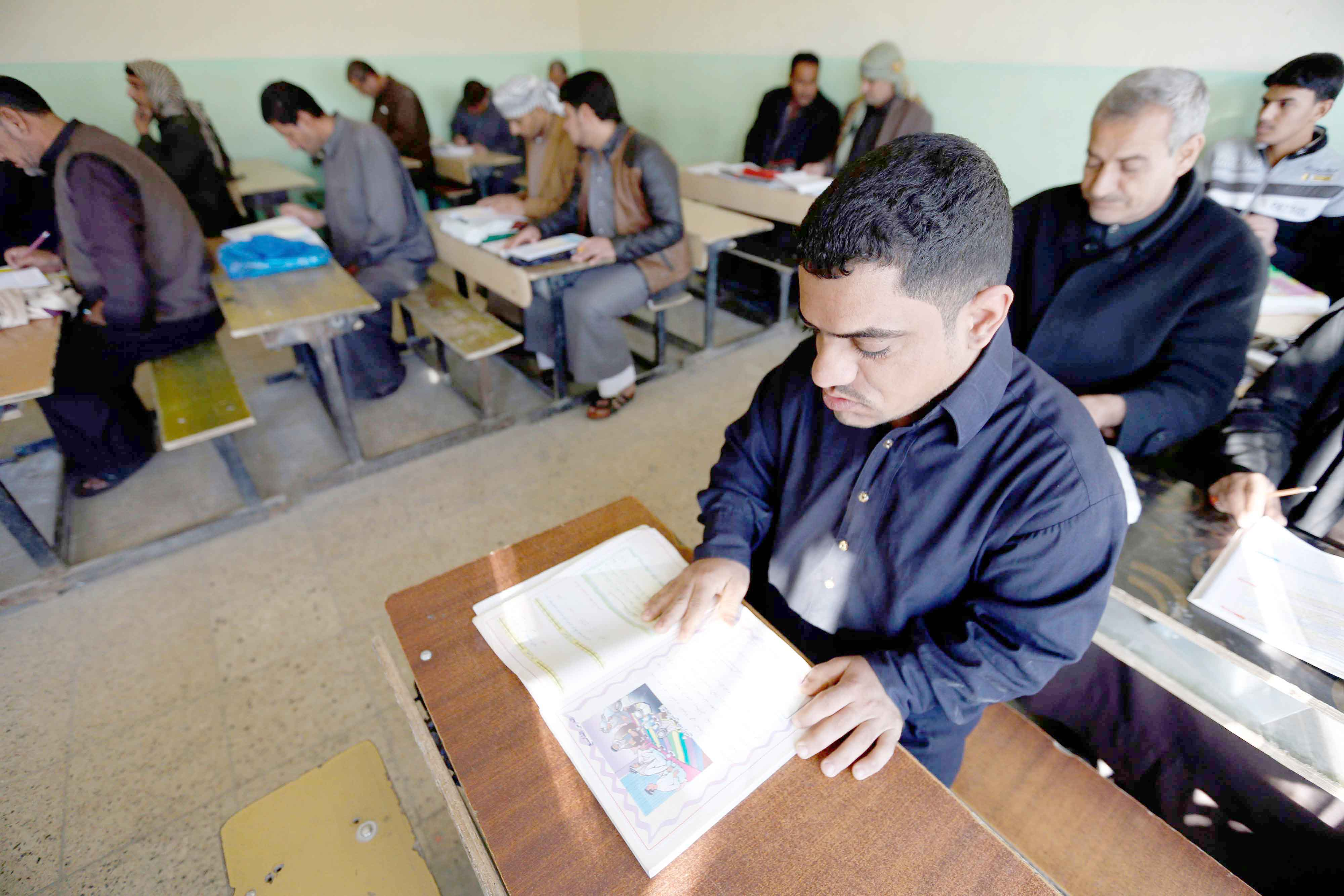 Catching up. Iraqi men take part in an Iraqi government's literacy programme for adults in the holy city of Najaf.(AFP)