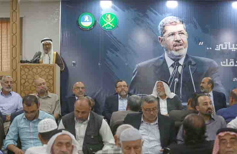 Risk of violence. Members of the Jordanian Islamic Action Front Party receive condolences for the death of former Egyptian President Muhammad Morsi at IAF headquarters in Amman, June 18. (AFP)