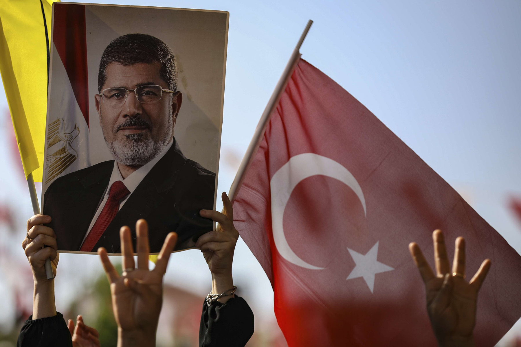 Islamist demonstrators attend event for Muhammad Morsi, at Fatih Mosque in Istanbul, June 18. (AP)