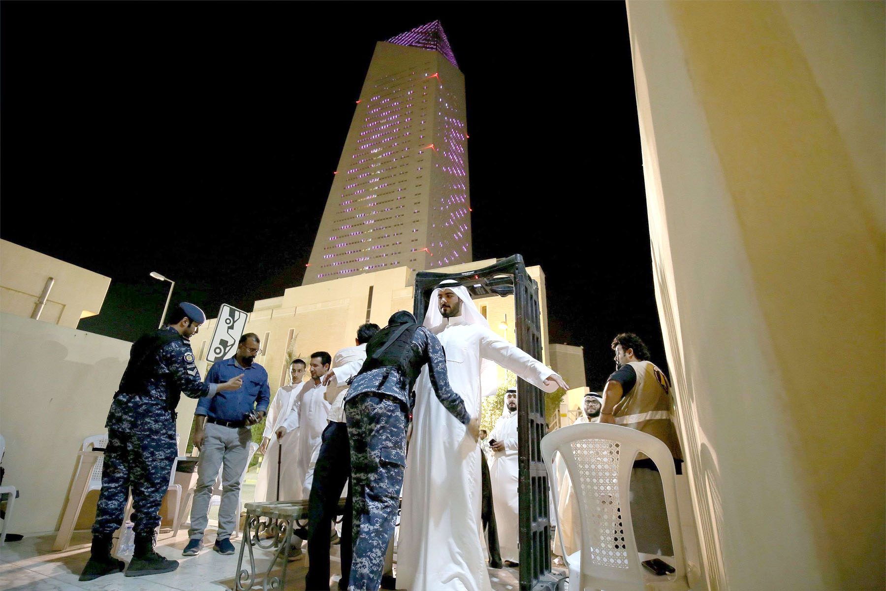 Men pass a security check before entering to pray in Kuwait City's Grand Mosque. (AFP)
