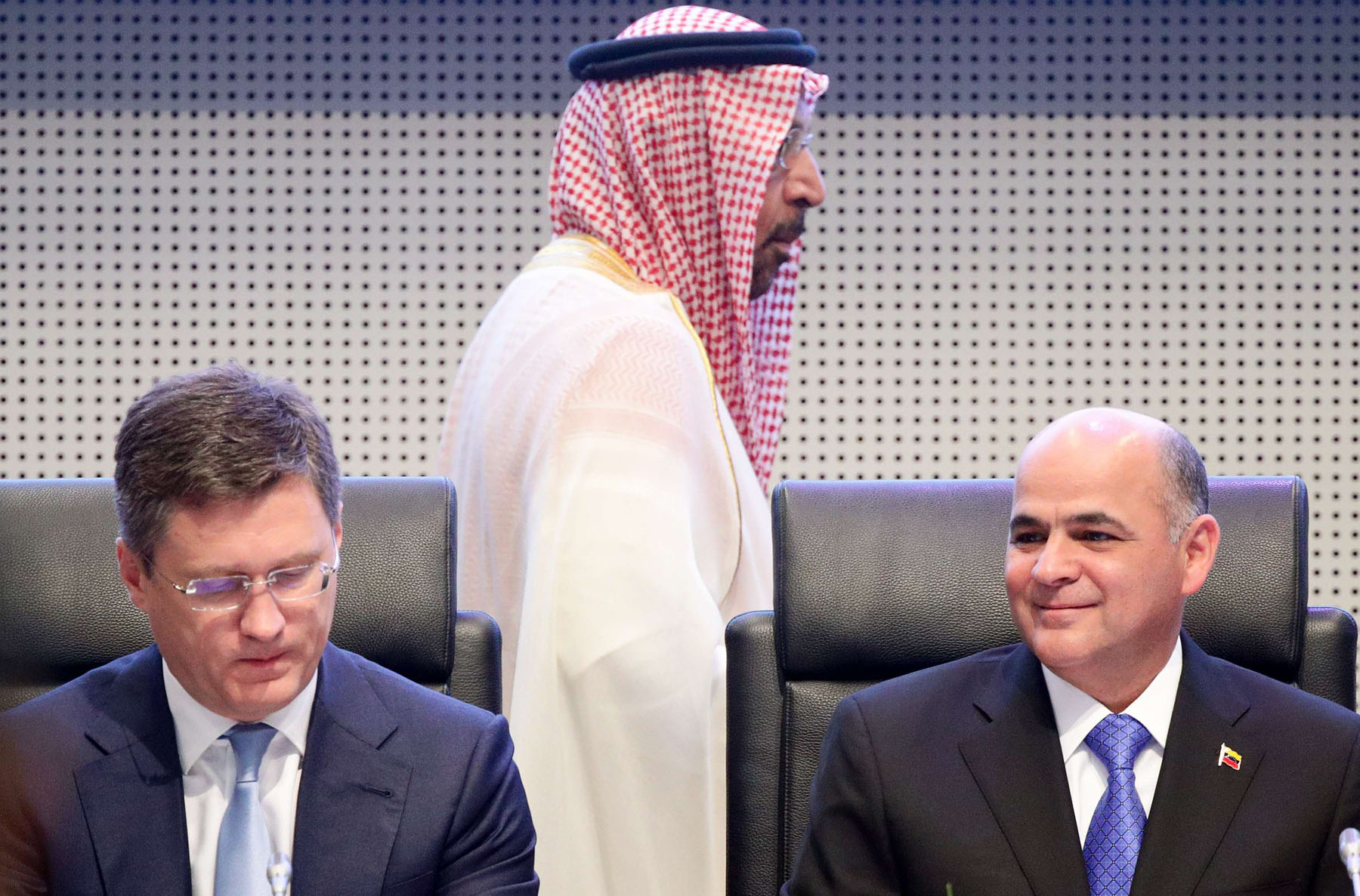 Russian Energy Minister Alexander Novak (L), Venezuela's Oil Minister Manuel Quevedo (R) and Saudi Arabia's Oil Minister Khalid al-Falih at an OPEC+ meeting in Vienna, July 2. (Reuters)