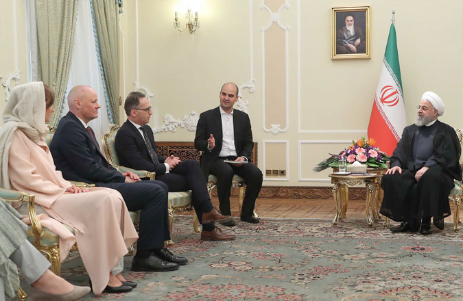 Mutual mistrust. Iranian President Hassan Rohani (R) meets with German Foreign Minister Heiko Maas (2nd R) and members of his delegation in Tehran, June 10. (AFP)