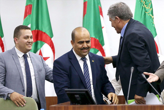 Fast-paced manoeuvres. New Speaker of the Algerian parliament Slimane Chenine (C) arrives to deliver a speech in Algiers, July 10. (AFP)