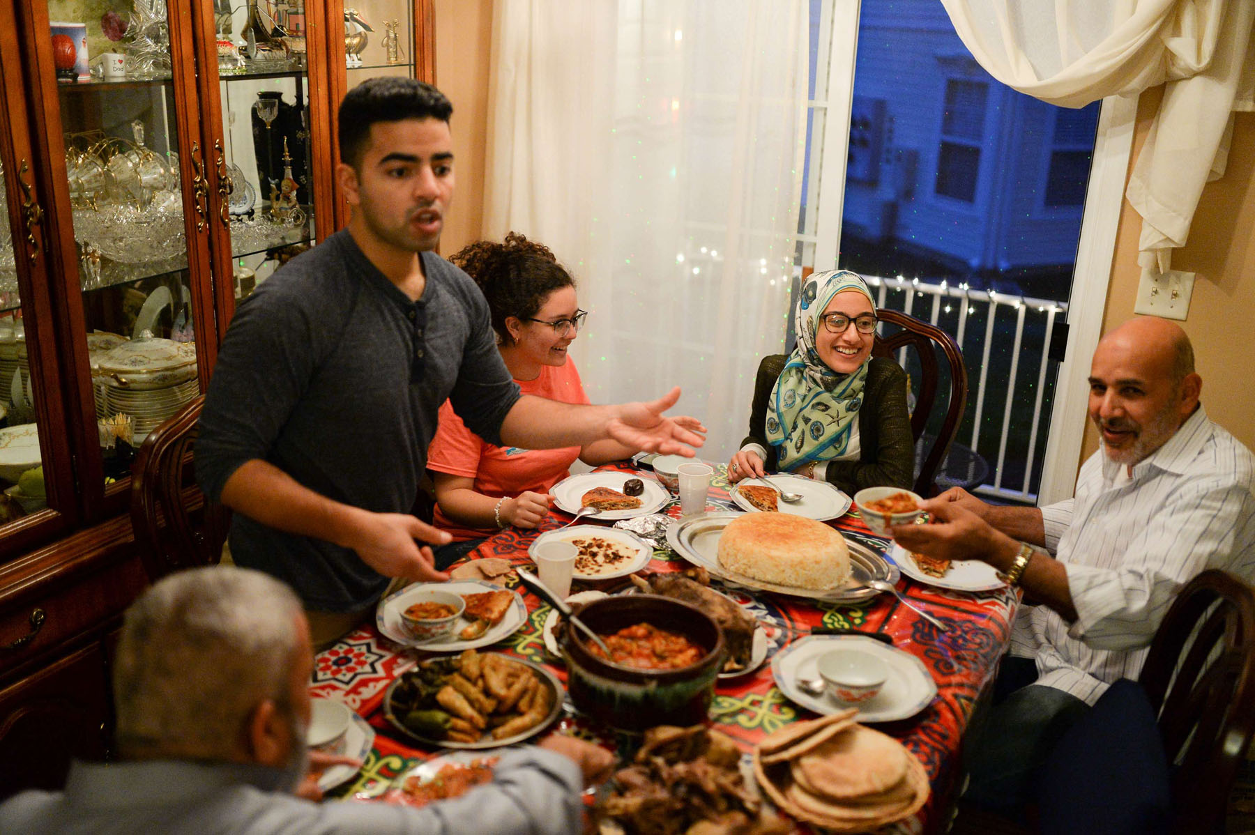 An Egyptian-American family and their friends enjoy dinner at their house in Manalapan, New Jersey.          (Reuters)