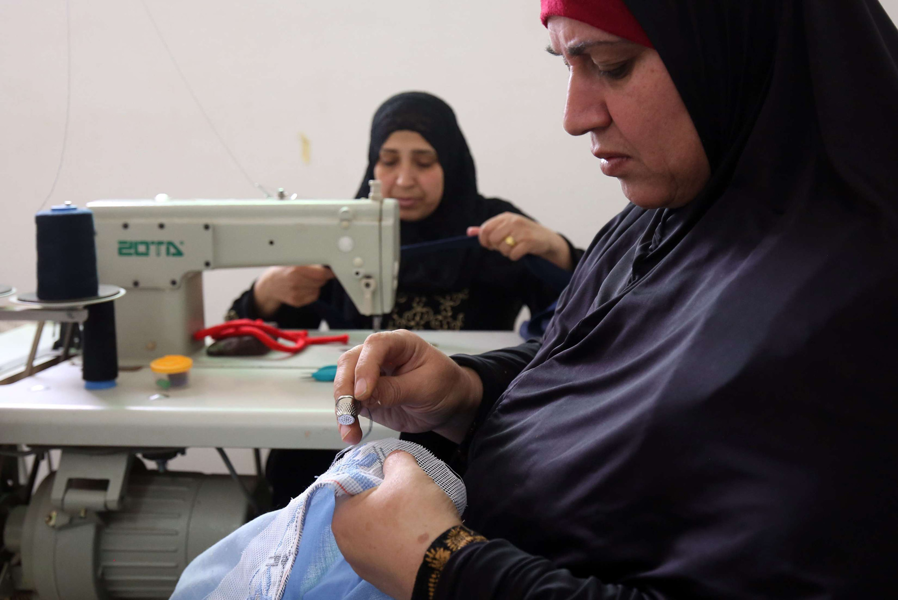 Women embroider at a workshop in north of Amman. (AFP)