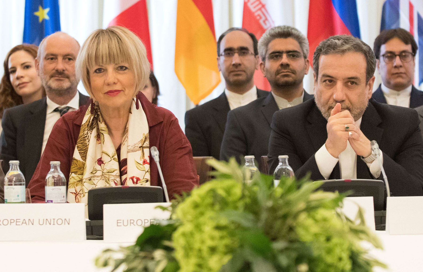 Iran's Deputy Foreign Minister Abbas Araghchi (R) and Secretary-General of the European Union's External Action Service Helga Schmid (L) take part in a meeting in Vienna, June 28. (AFP)