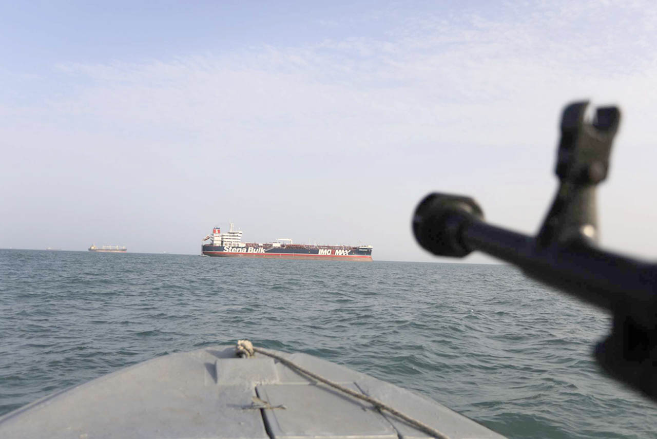 Lethal force. A speedboat of Iran's Islamic Revolutionary Guard Corps aims a weapon towards the British-flagged oil tanker Stena Impero in the Iranian port of Bandar Abbas, July 21. (AP)