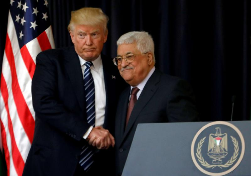 A file photo shows US President Donald Trump shaking hands with Palestinian President Mahmoud Abbas in the Palestinian town of Bethlehem, in the Israeli-occupied West Bank, 2017. (Reuters)