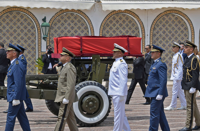 Tunisian military officers escort the coffin of late President Beji Caid Essebsi during his state funeral at the presidential palace in Tunis, July 27. (Reuters)
