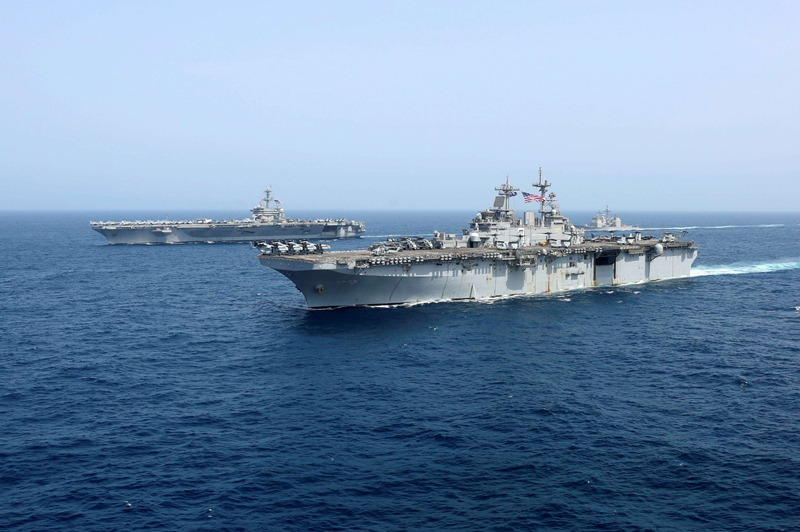 US Navy aircraft carrier USS Abraham Lincoln and amphibious assault ship USS Kearsarge sail in the Arabian Sea, May 17. (US Navy via Reuters)