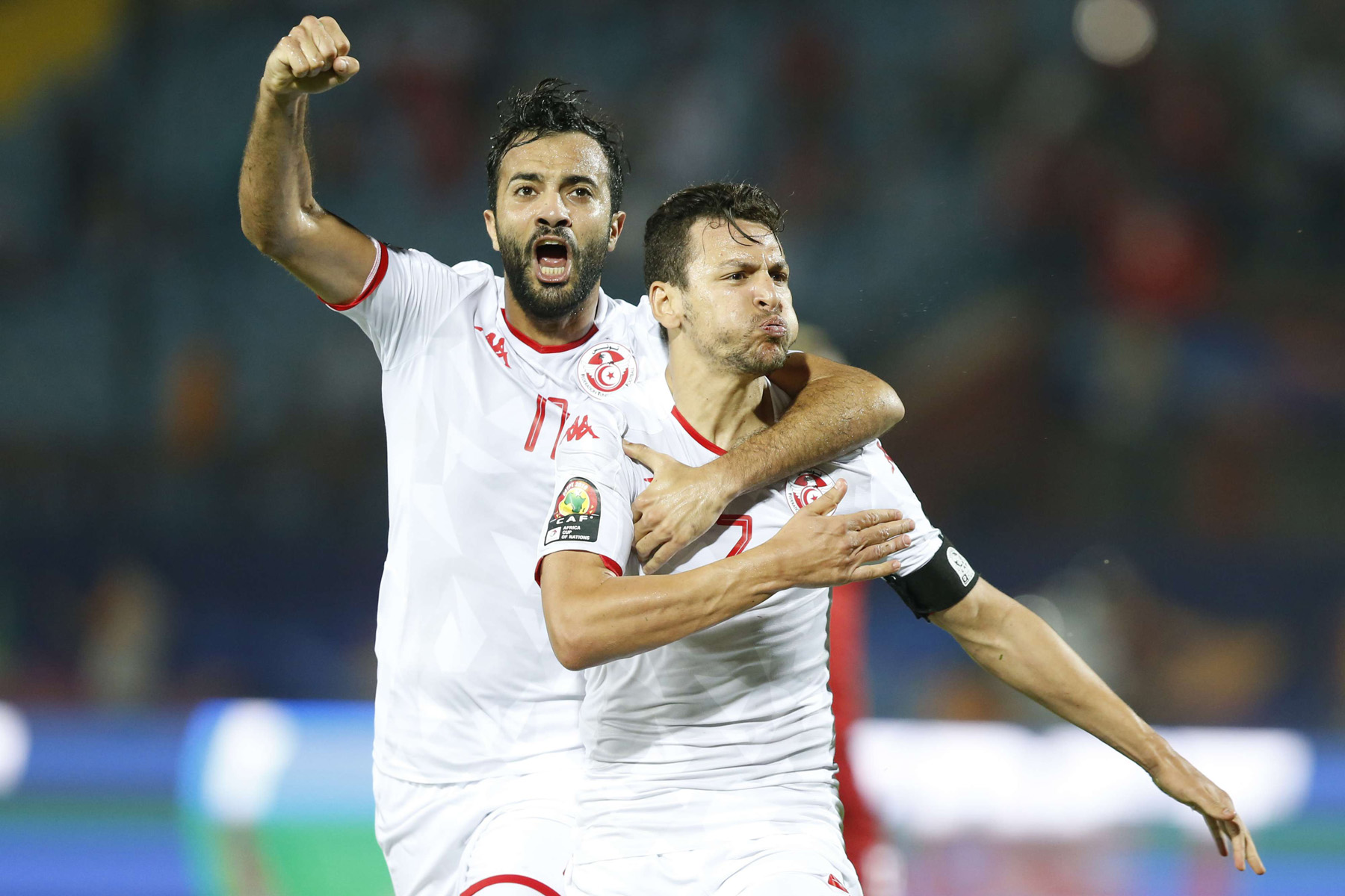 Tunisia's Youssef Msakni, right and Tunisia's Taha Khenissi celebrate after scoring during the African Cup of Nations quarterfinal soccer match between Madagascar and Tunisia in Al Salam stadium in Cairo, Egypt, Thursday, July 11, 2019. (AP)