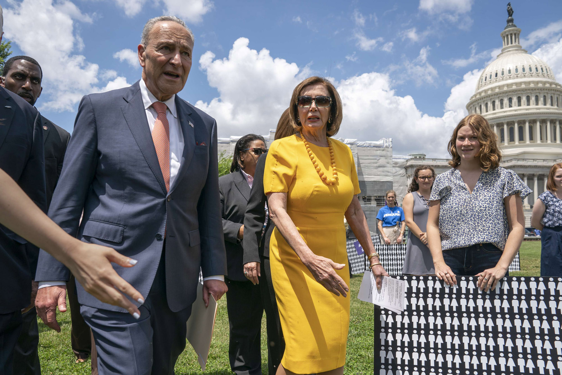 US Senate Democratic Leader Chuck Schumer (L) and House Speaker of the House Nancy Pelosi (C) walk at the Capitol in Washington following a briefing on Iran, June 20. (AP)