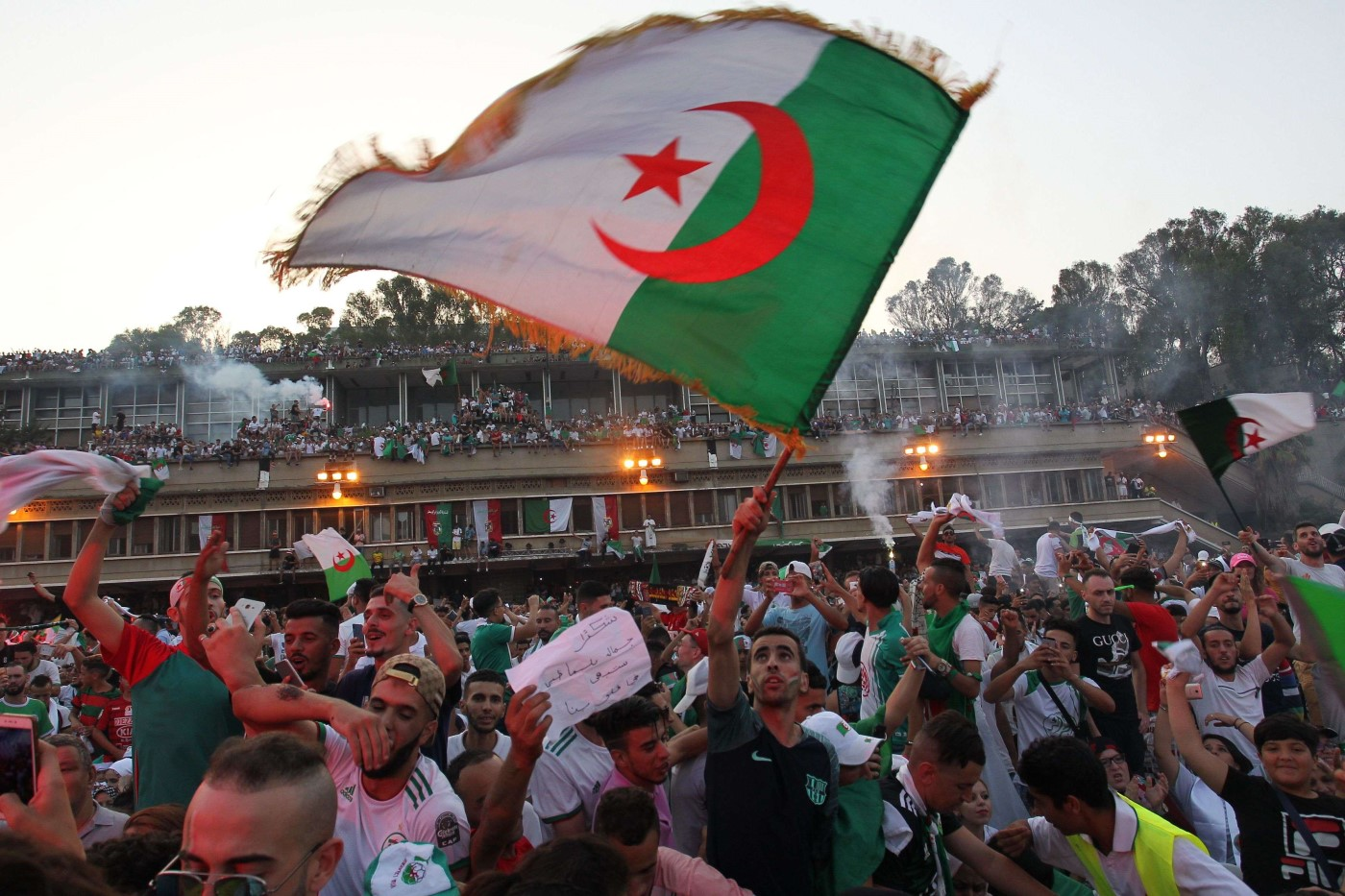Algerian fans celebrate after their team won the 2019 Africa Cup of Nations (CAN) Final football match between Senegal and Algeria, in Algiers on July 19, 2019. (AFP)