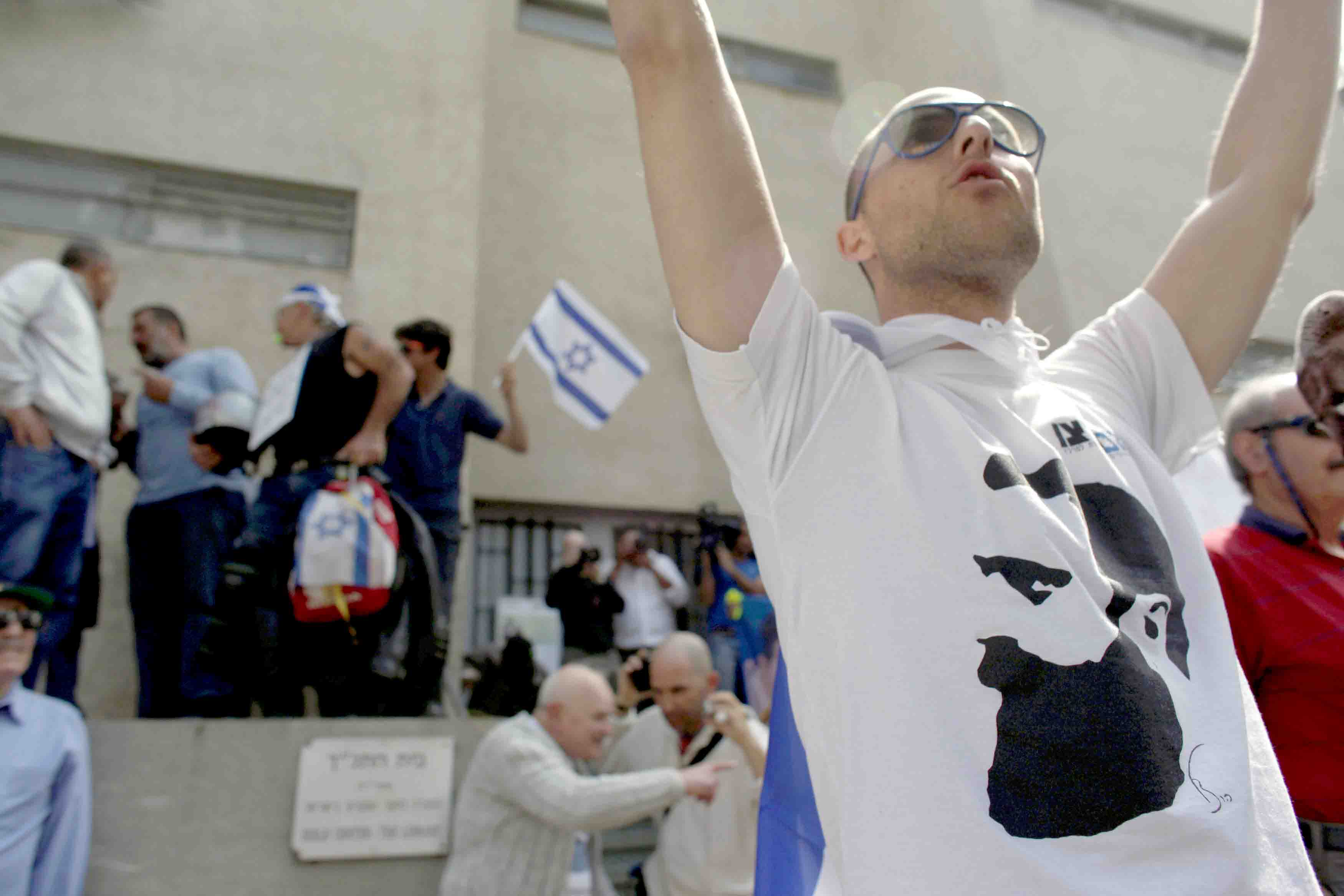 A ring-wing protester and supporter of Im Tirtzu demonstrates at an event held by Israeli left-wing artists and academics in Tel Aviv. (Reuters)