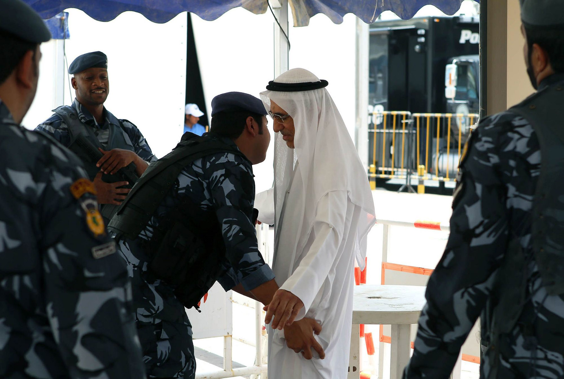 A matter of security. A Kuwaiti man is searched by security members outside a mosque in Kuwait City.	 (AFP)