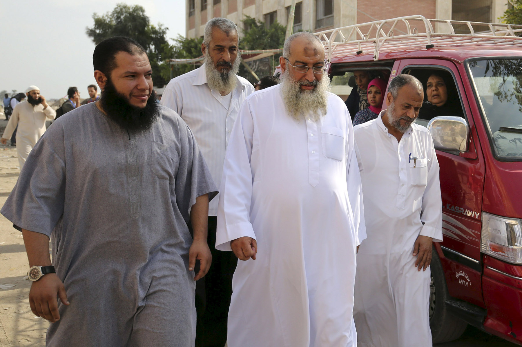 Yasser Borhami (C), deputy head of the Salafist Call, walks with his supporters in Alexandria. (Reuters)
