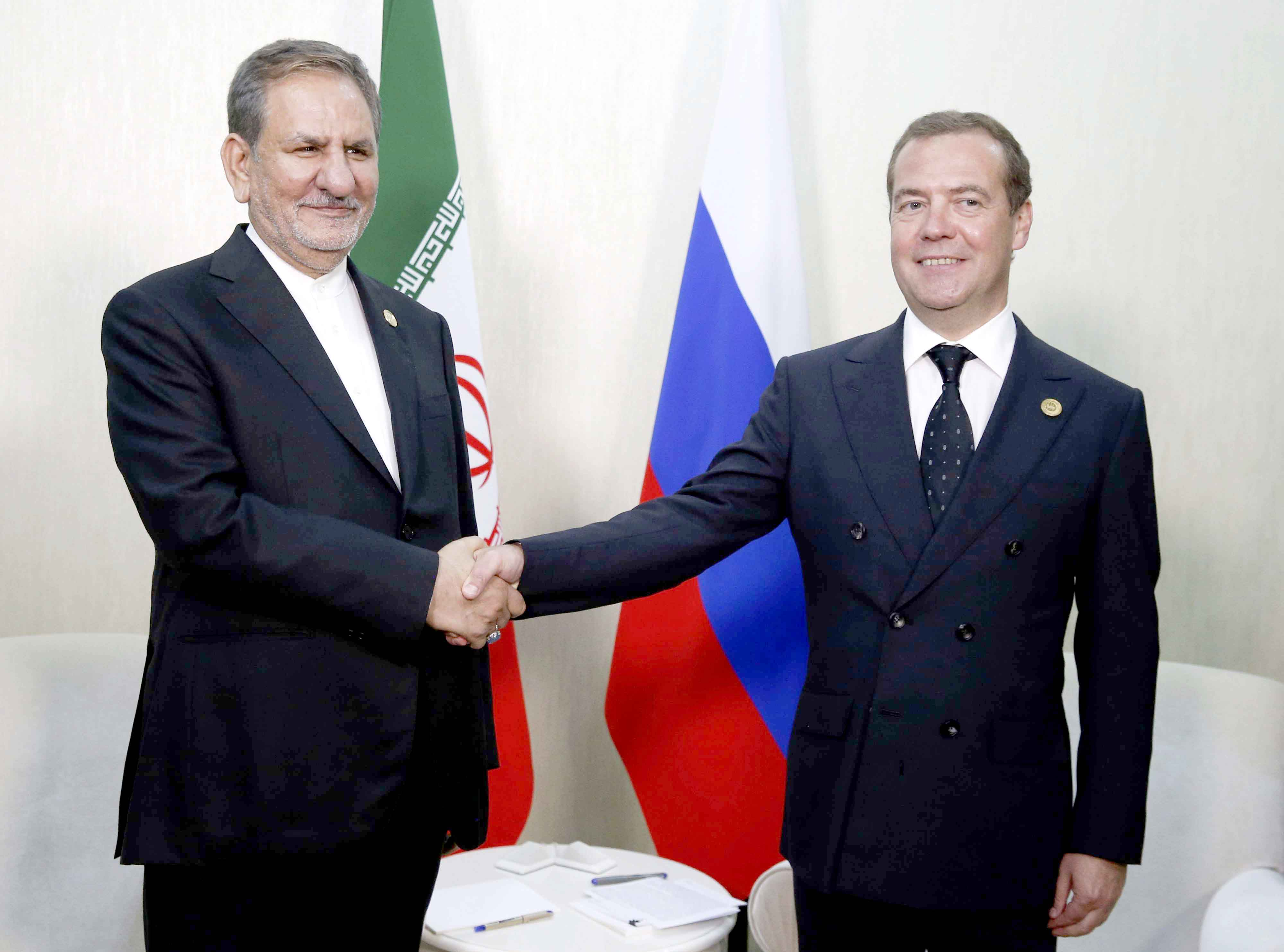 Russian Prime Minister Dmitry Medvedev (R) and Iranian Vice President Eshaq Jahangiri at the First Caspian Economic Forum in Turkmenbashi, Turkmenistan, August 12. (AP)