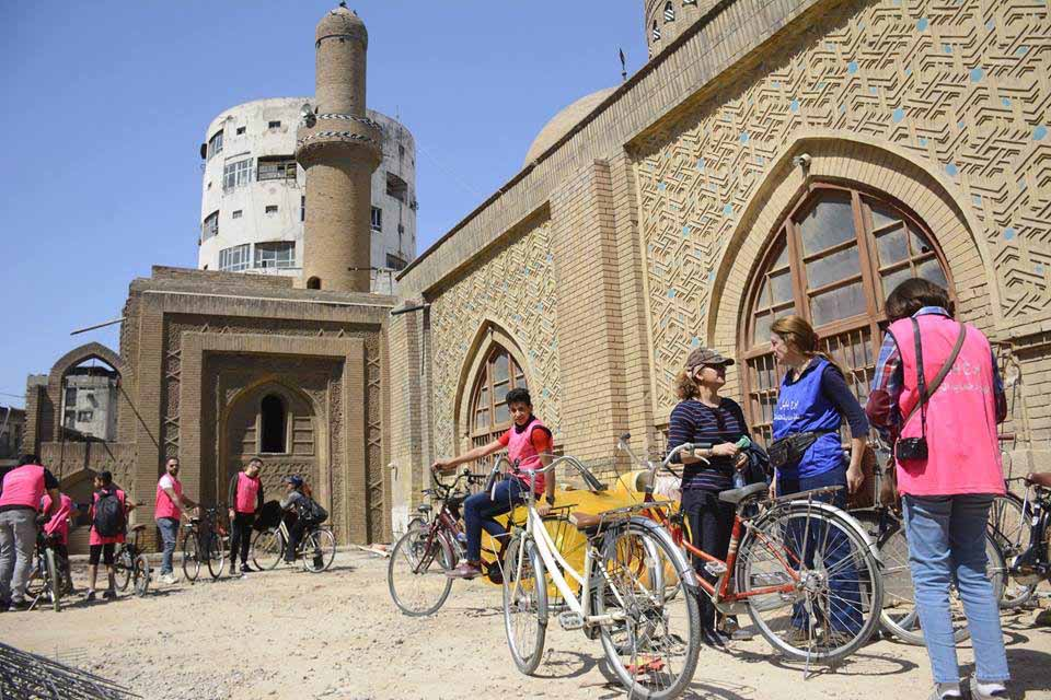 Activists rest near an old building in Baghdad.(Courtesy of Burj Babel)