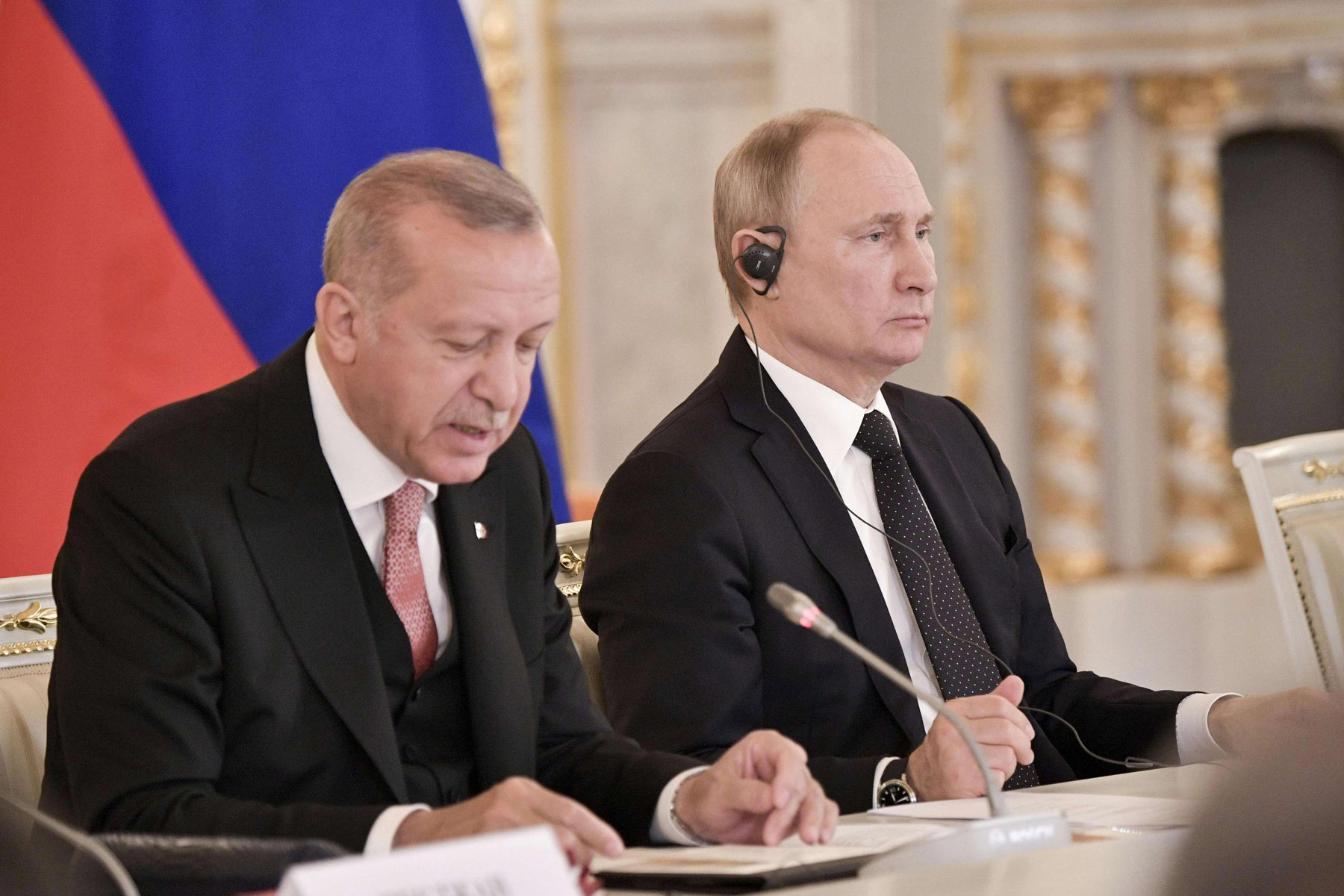 Turkish President Recep Tayyip Erdogan (L) speaks next to Russian President Vladimir Putin during a meeting in Moscow, April 8. (AFP)