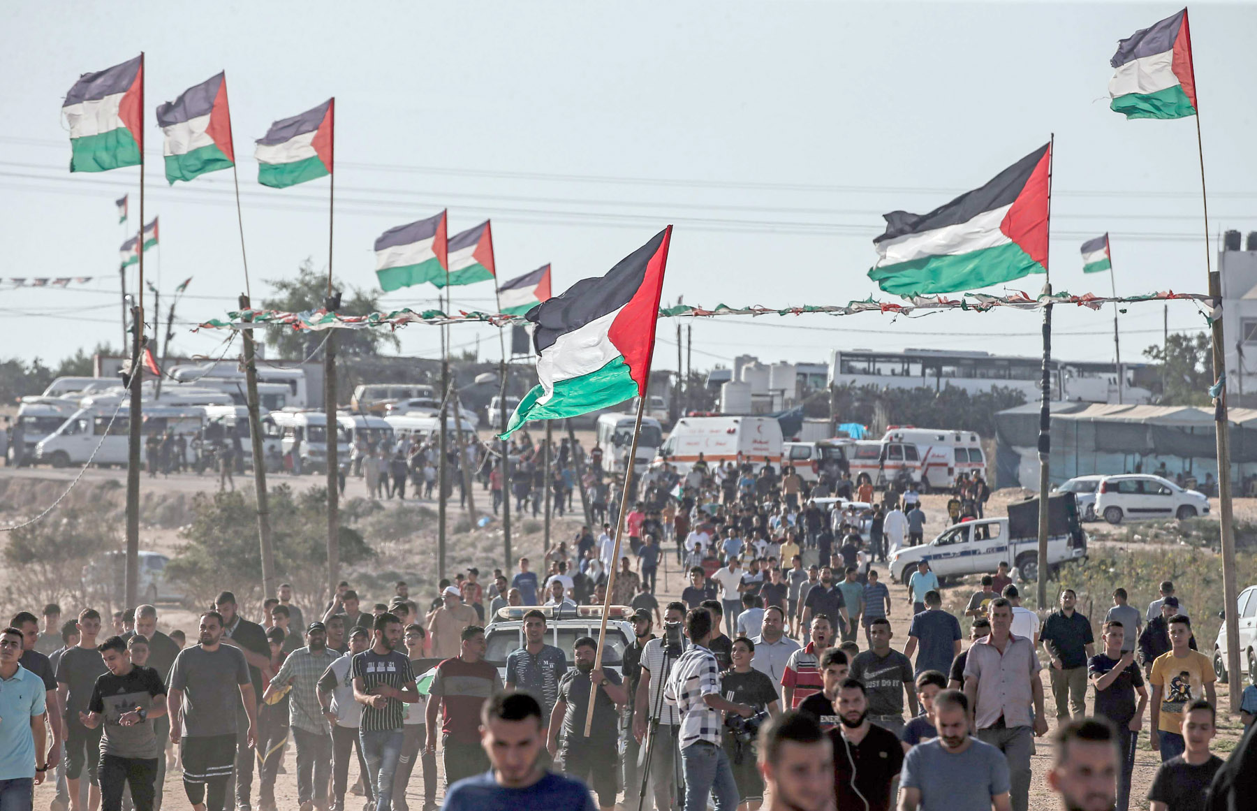 Palestinians demonstrate near the fence along the border with Israel in the eastern Gaza Strip, August 16. (AFP)