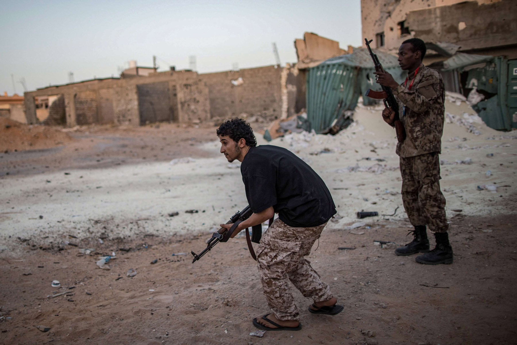 Fighters of Libya's UN-backed Government of National Accord of Fayez al-Sarraj take their position during clashes with LNA forces in Tripoli. (DPA)