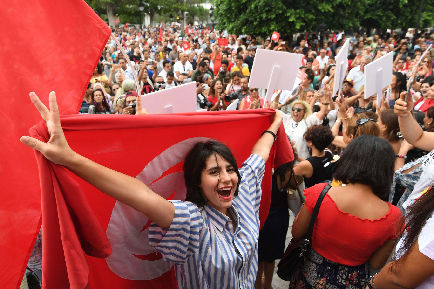 A 2018 file picture shows Tunisians chanting slogans during a demonstration to demand equal inheritance rights between men and women in Tunis. (AFP)