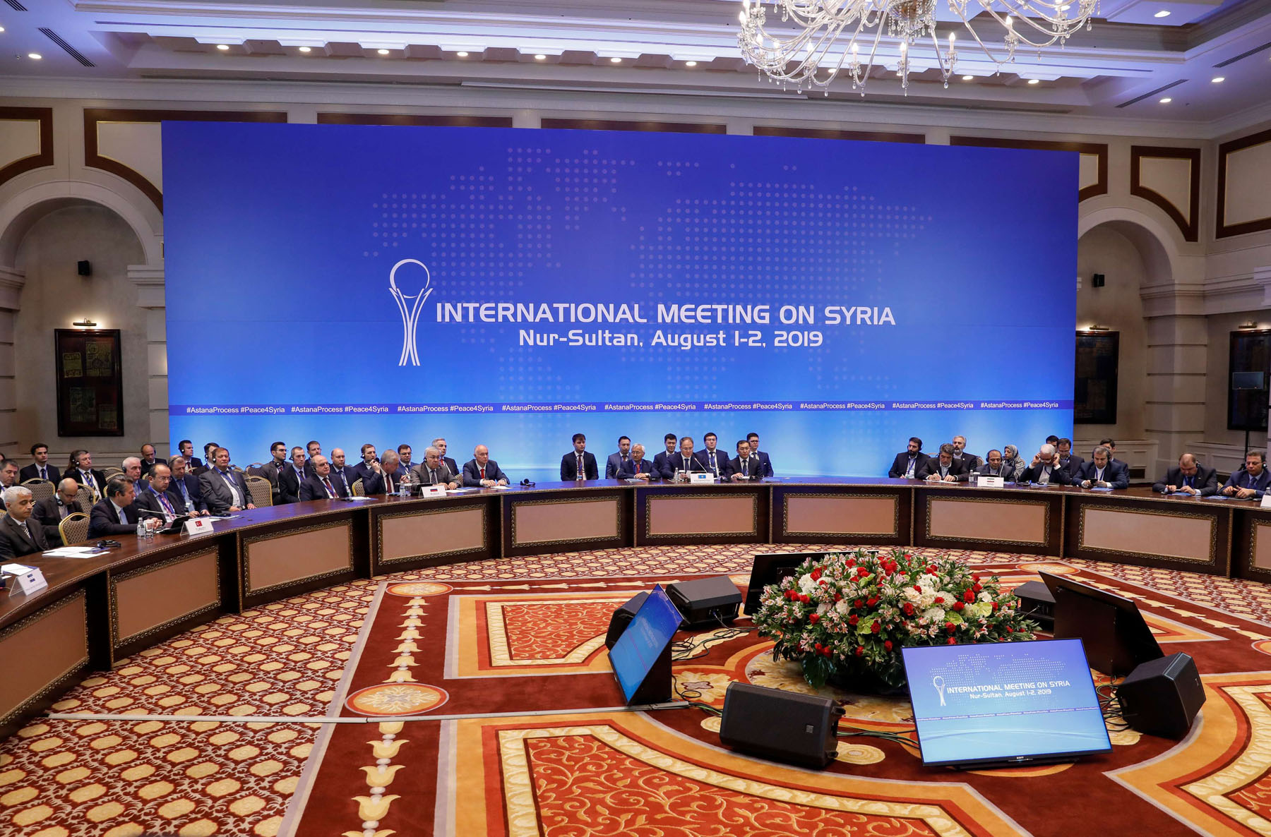 Officials attend a session of the peace talks on Syria in Nur-Sultan, Kazakhstan, August 2. (Reuters)