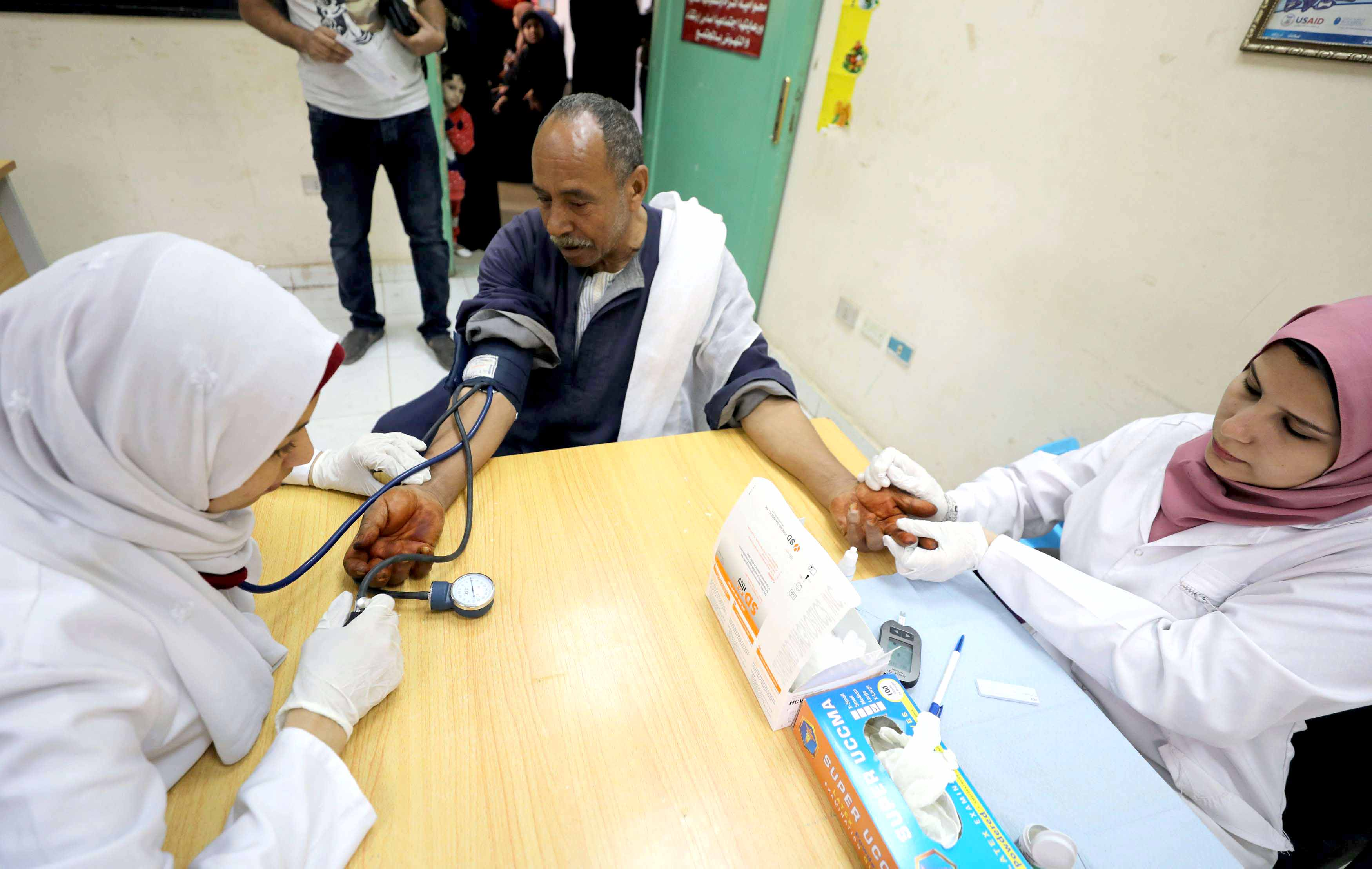 Egyptian doctors make a test during a campaign that aims to test 50 million people to detect and treat hepatitis C patients in Cairo. (Reuters)