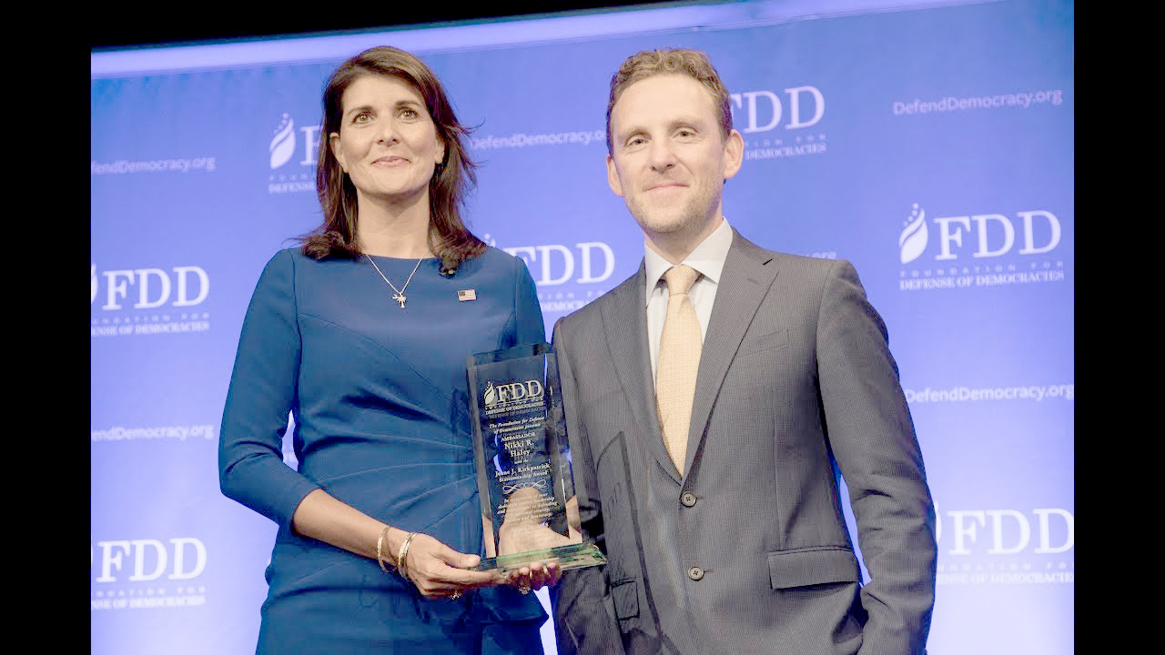 A 2018 file picture shows FDD's CEO Mark Dubowitz (R) presenting former United Nations ambassador Nikki Haley with the Jeane J. Kirkpatrick Statesmanship Award. (FDD)