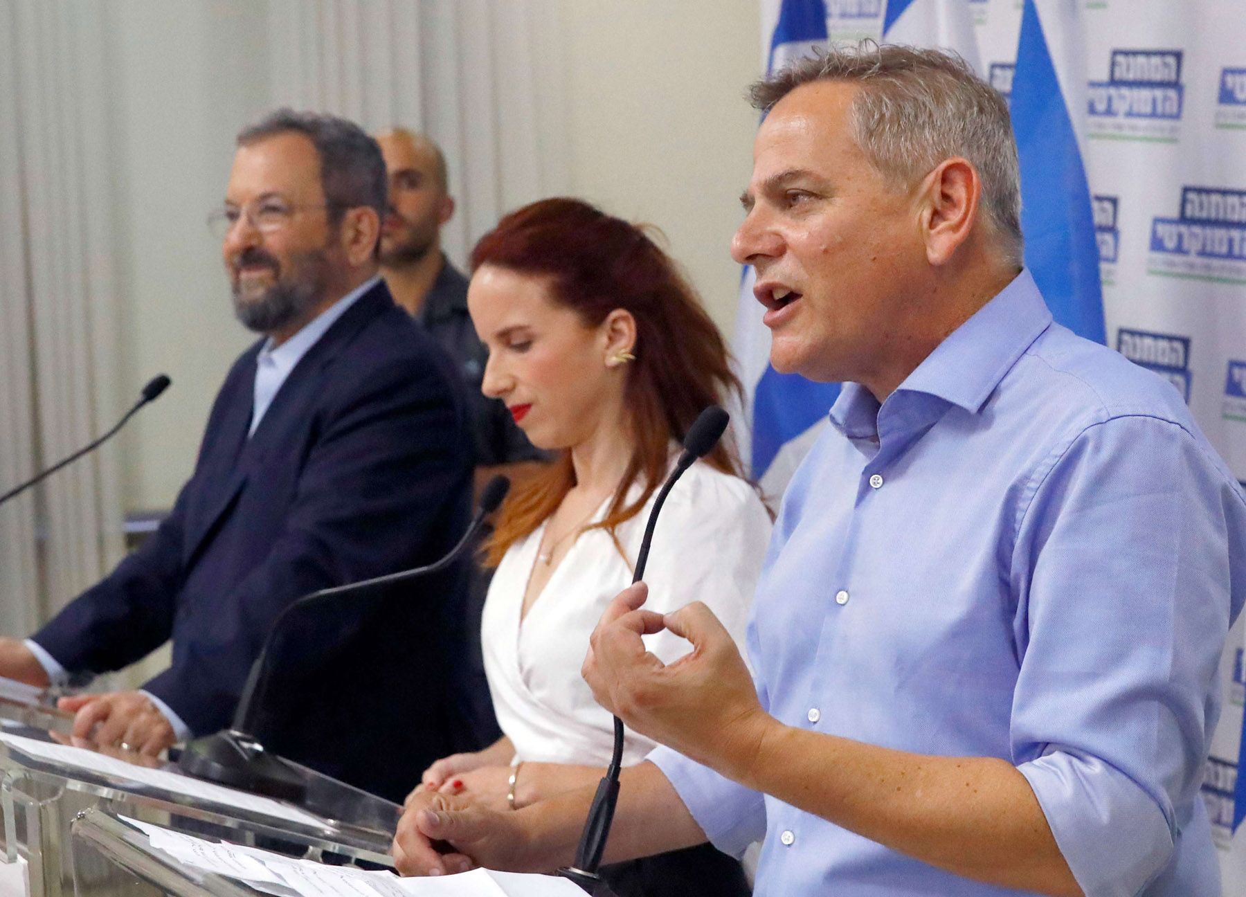 More of the same? Former Israeli Prime Minister Ehud Barak (L) attends the launch of the Democratic Union list, which he formed with newly elected Meretz head Nitzan Horowitz (R) and Stav Shaffir (C), Tel Aviv, July 25.  (AFP)