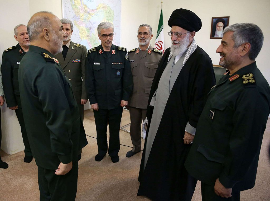 Not a peace team. Iran's Supreme Leader Ayatollah Ali Khamenei (2nd R) decorates Major General Hossein Salami (L) as head of the Iranian Islamic Revolutionary Guards Corps in Tehran, last April. (AFP)