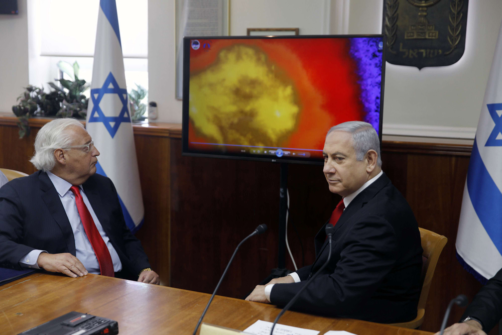 Israeli Prime Minister Benjamin Netanyahu (R) and US Ambassador to Israel David Friedman watch a video which shows the launch of the Arrow 3 hypersonic anti-ballistic missile, Jerusalem, July 28. (AP)