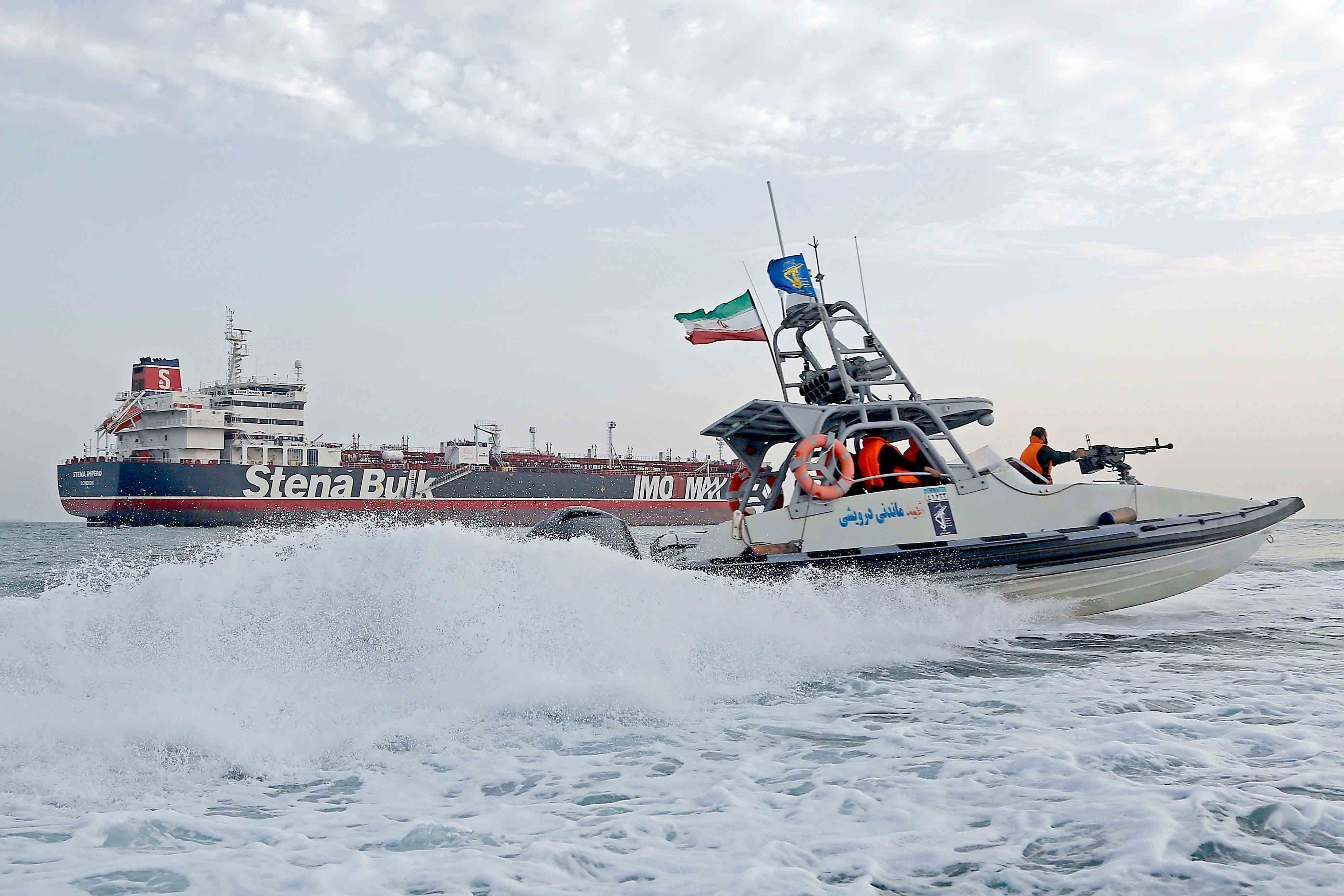 Iranian Revolutionary Guards patrol around the British-flagged tanker Stena Impero as it's anchored off the Iranian port city of Bandar Abbas, July 21. (AFP)