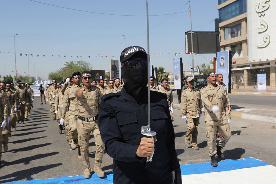 Iranian clout. Iraqi Popular Mobilisation Forces march in Baghdad, May 31. (AP)