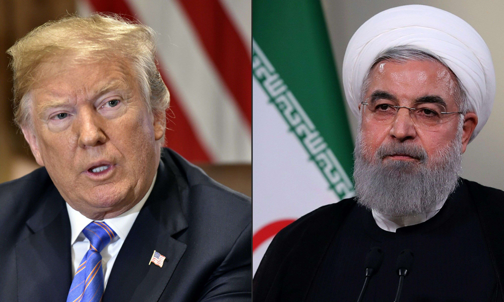 A combination of photo shows US President Donald Trump (L) and Iranian President Hassan Rohani. (AFP)