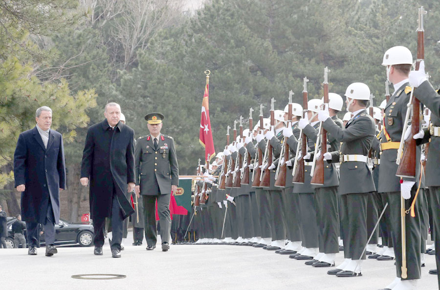 Turkish President Recep Tayyip Erdogan (2nd L),  accompanied by Defence Minister Hulusi Akar (L), reviews a guard of honour at the Turkish Military Academy in Ankara, January 24. (Reuters)