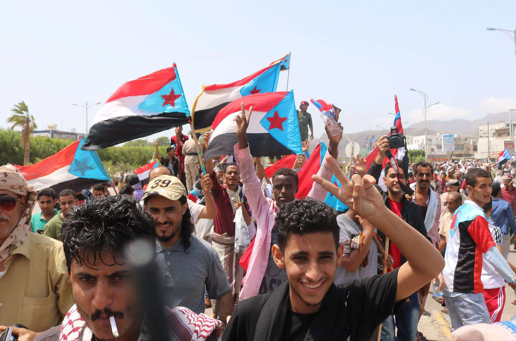 Yemeni demonstrators wave flags of former South Yemen as they march in Yemen's second city of Aden, August 15. (AFP)
