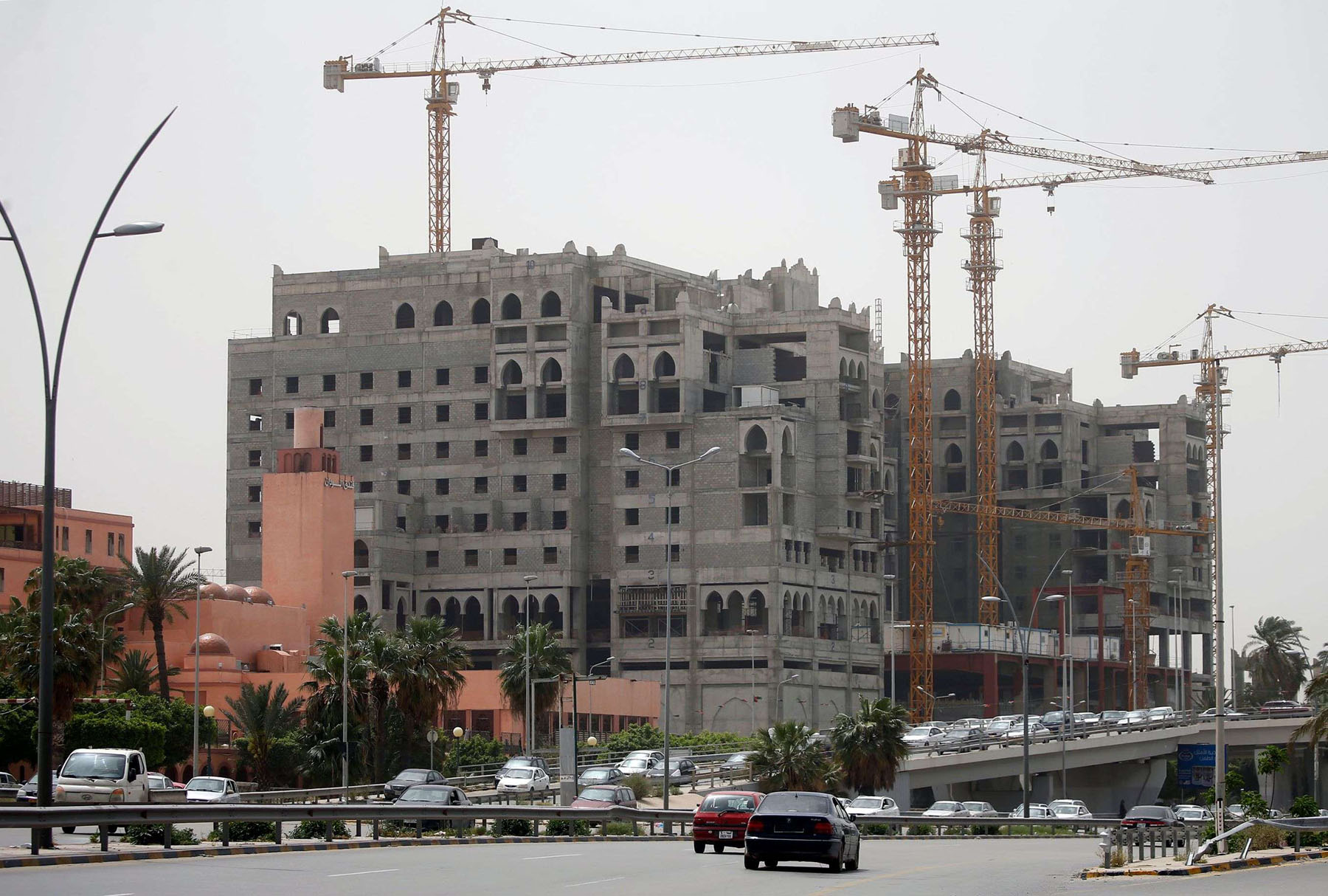 Looking ahead. A hotel under construction in downtown Tripoli, Libya.  (AFP)