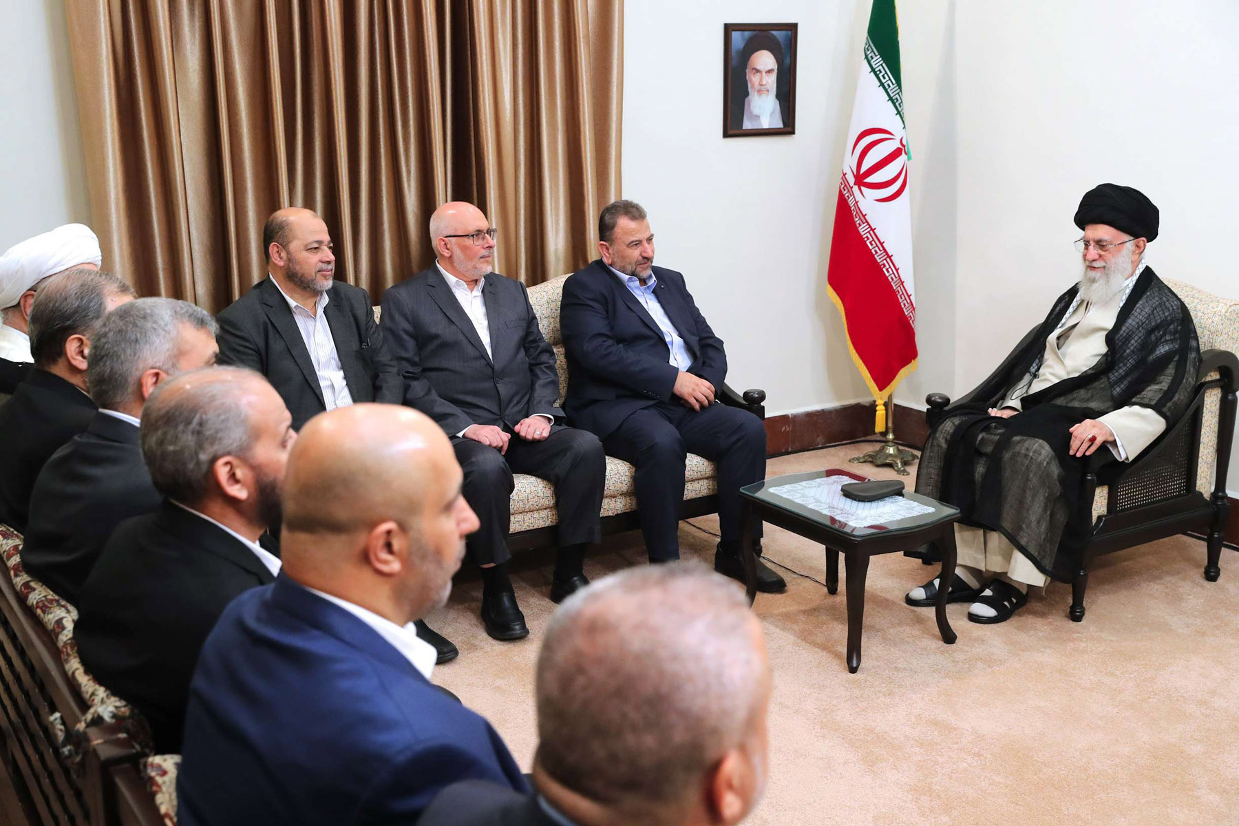 Iranian Supreme Leader Ayatollah Ali Khamenei, right, meets Hamas deputy chief, Saleh al-Arouri, second right, and the Hamas delegation, in Tehran, Iran, Monday, July 22. (Office of the Iranian Supreme Leader via AP)