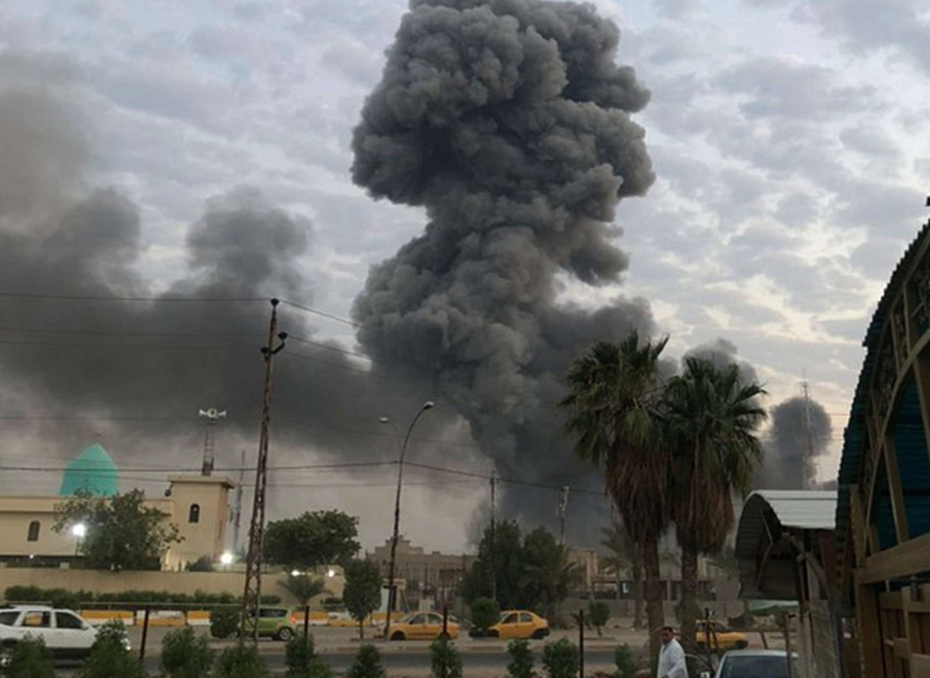 In this Monday, Aug. 12, 2019 file photo, plumes of smoke rise after an explosion at a military base southwest of Baghdad, Iraq. (AP)