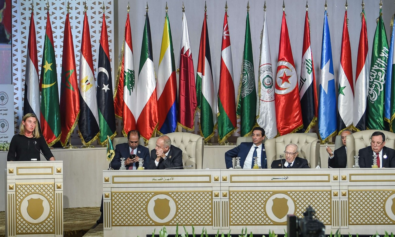 Federica Mogherini (L), EU High Representative for Foreign Affairs and Security Policy, addresses delegates attending the opening session of the 30th Arab League summit in the Tunisian capital Tunis on March 31. (AFP)