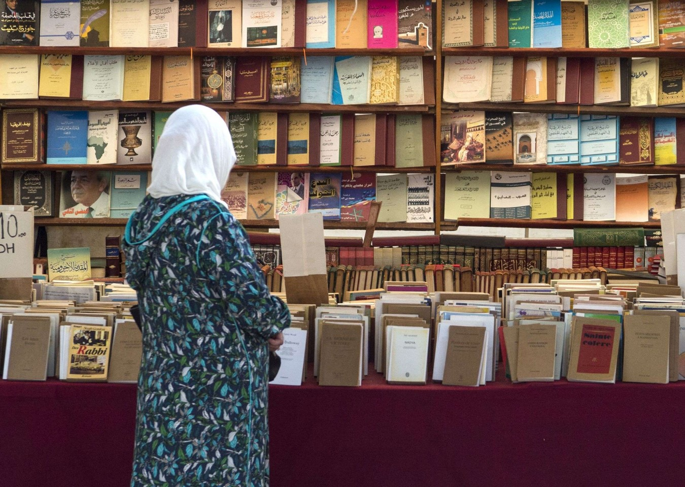 A customer browses books at a bookshop in the Moroccan capital Rabat on August 9, 2018. (AFP)