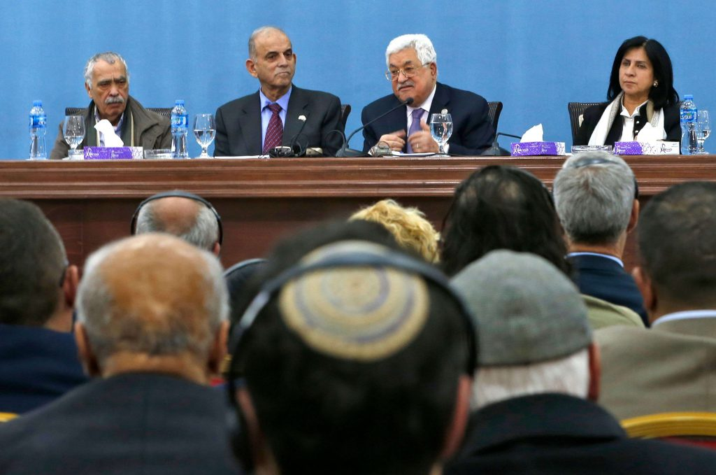Palestinian president Mahmoud Abbas (C-R) speaks alongside Ran Cohen (C-L), Israeli former Knesset (parliament) member for left-wing Meretz party, as they attend the Palestinian Peace and Freedom Forum in Ramallah, February 6, 2019. (AFP)