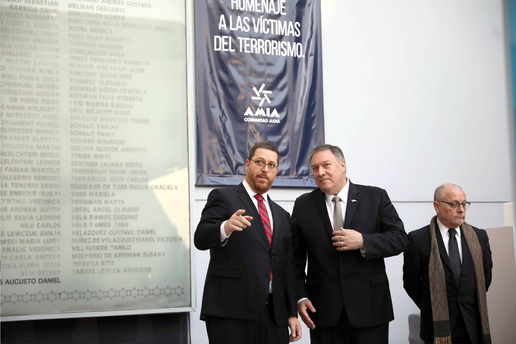 Ghosts of terror. AIMA President Ariel Eichbaum (L), US Secretary of State Mike Pompeo (C) and Argentine Foreign Minister Jorge Faurie attend a memorial service to honour the 85 people killed in Argentina's worst terrorist attack, in Buenos Aires, July 19. (AP)