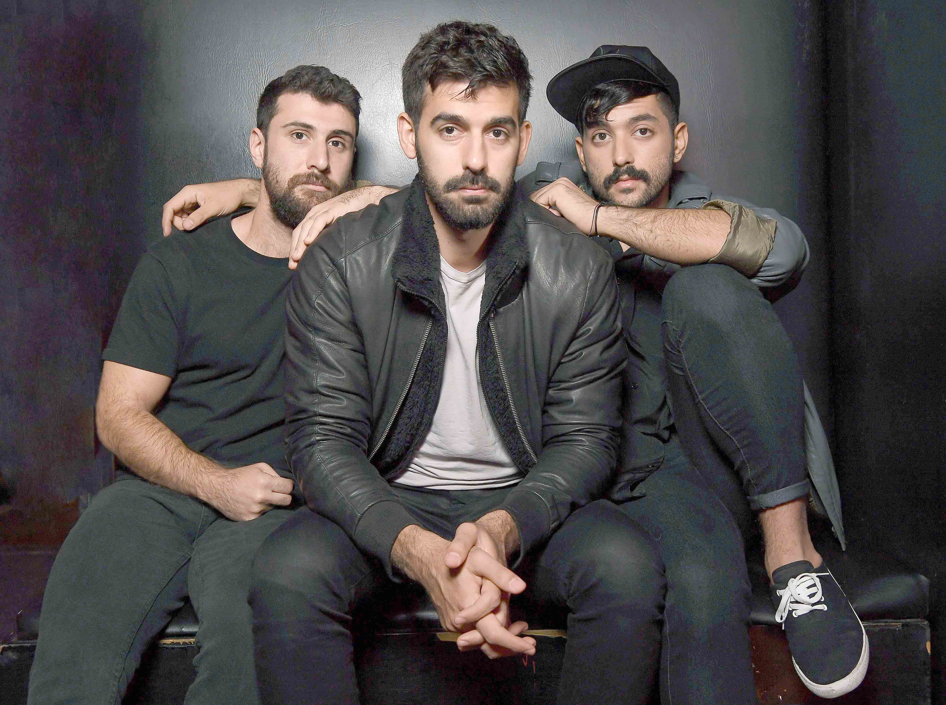 Musicians Haig Papazian (L), Carl Gerges (C) and Hamed Sinno of Mashrou' Leila pose for a picture in New York. (AFP)